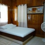 A bedroom at Villa Ranguana in Placencia, Belize