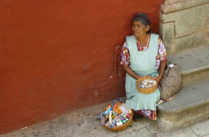 A old lady selling small items in Mexico