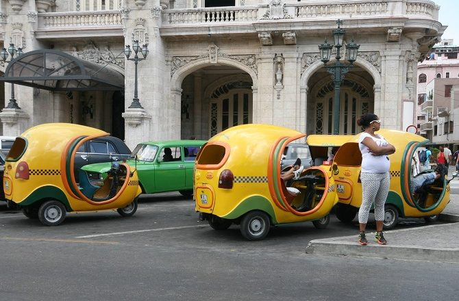 Yellow, auto rickshaws in Old Havana, Cuba