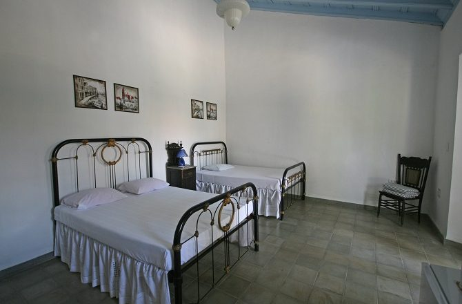 A bedroom at Casa Real 54 in Trinidad, Cuba