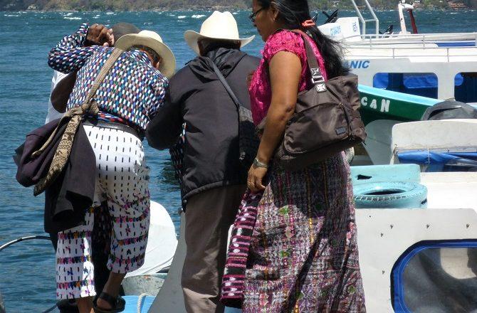 Passengers boarding a public boat on Lake Atitlan