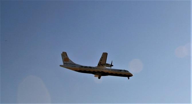 An Aerocaribbean aircraft in-flight over Cuba