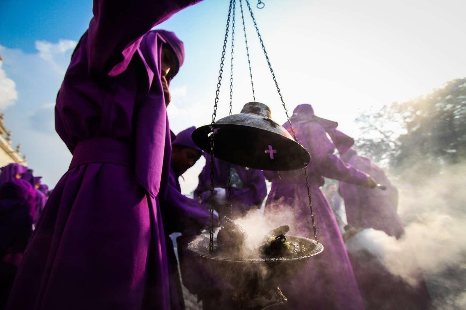 Burning incense during Semana Santa in Antigua, Guatemala