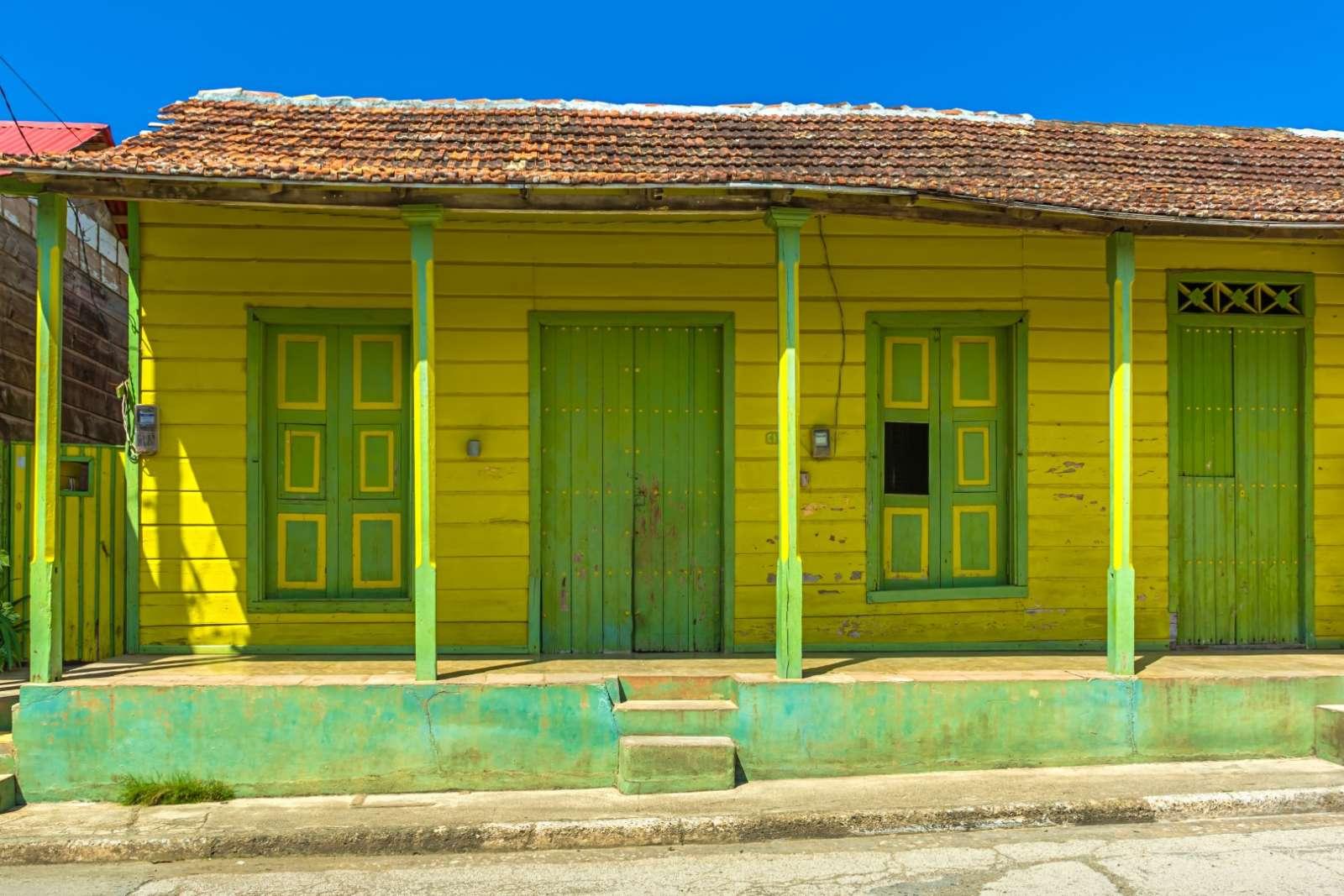 Old, yellow building in Baracoa, Cuba