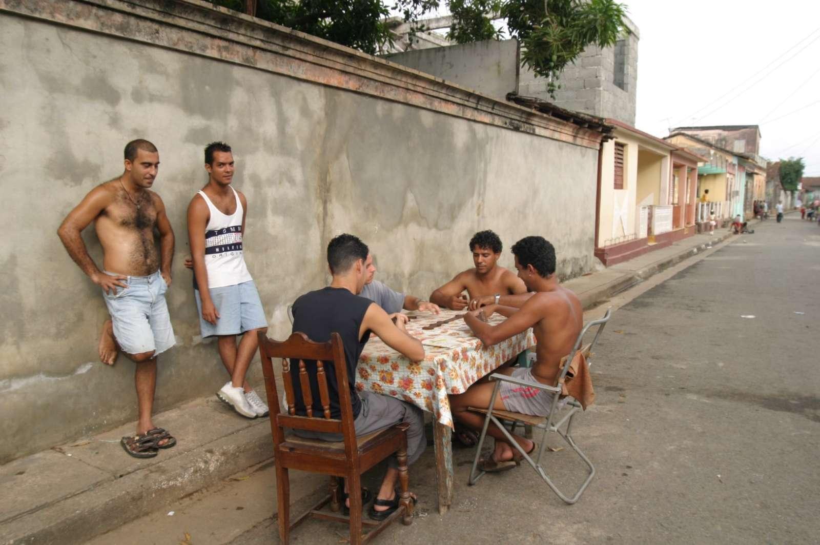 Men playing majong in Baracoa Cuba
