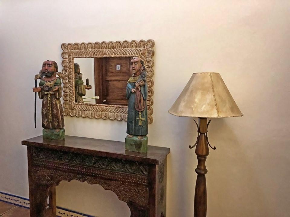 Mirror and statues at Casa Encantada in Antigua