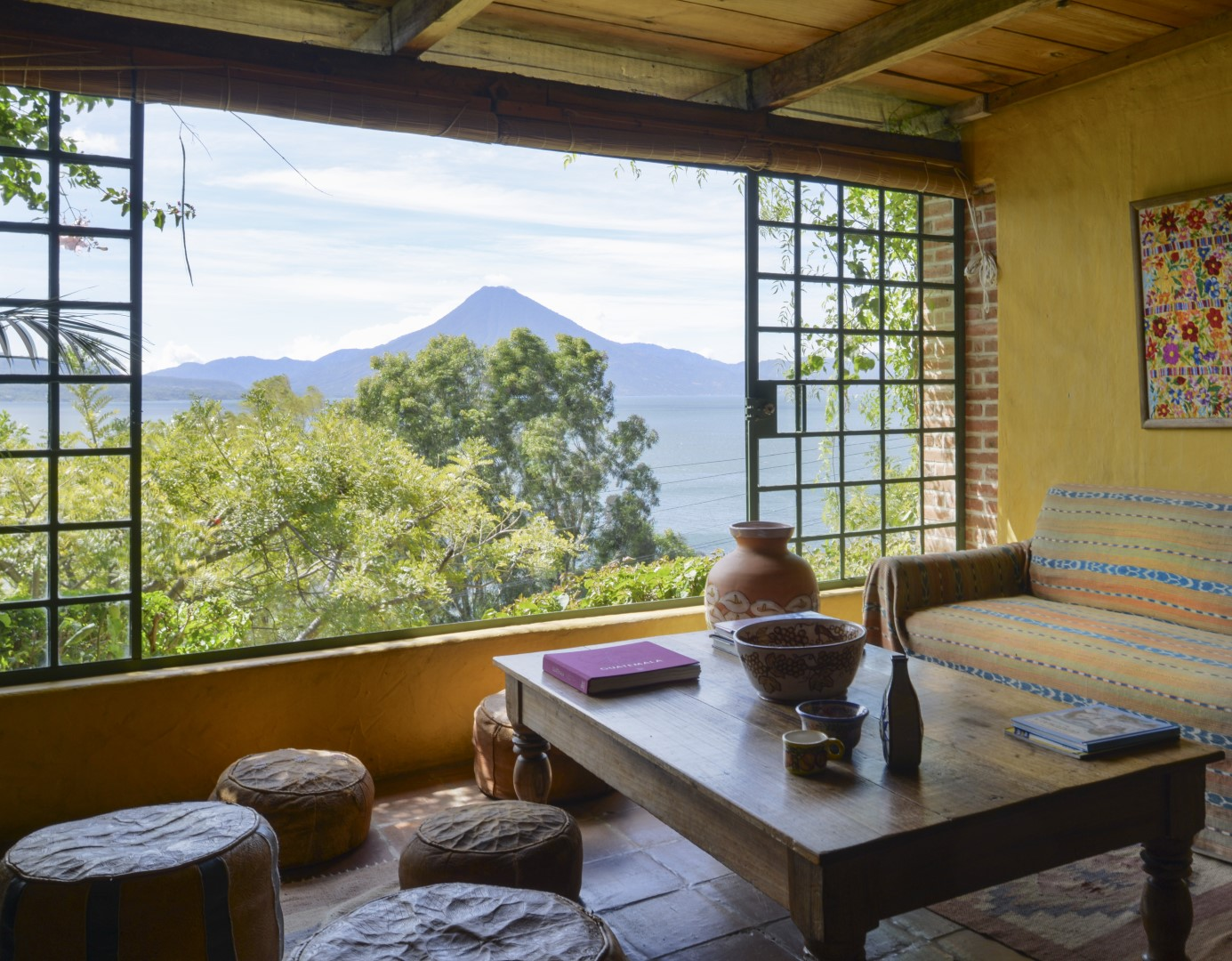 Indoor seating area with volcano view at Casa Palopo in Lake Atitlan
