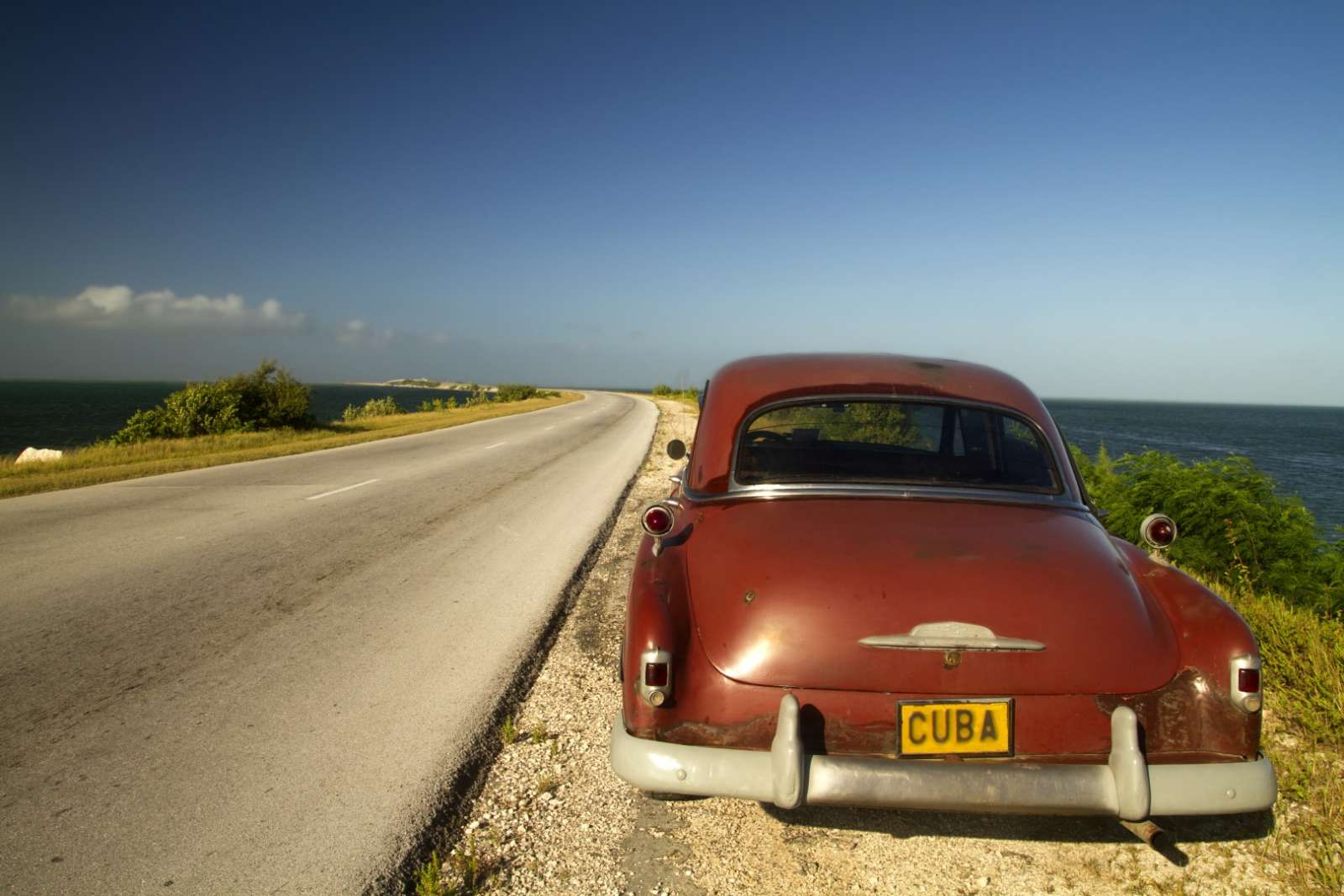 Classic car on the causeway to Cayos de Villa Clara, Cuba