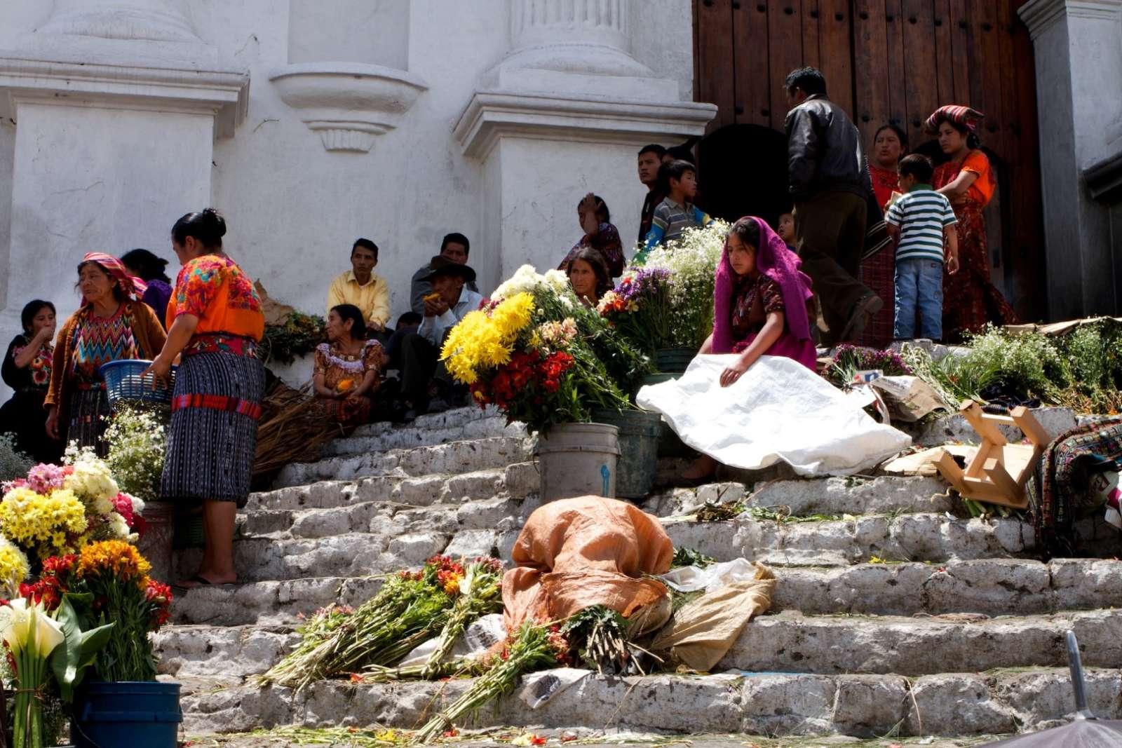 Girl selling flowers in Chichicastenango, Guatemala