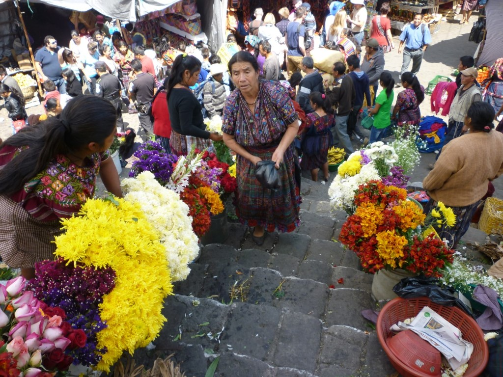Selling flowers on the church steps at Chichicastenango, Guatemala
