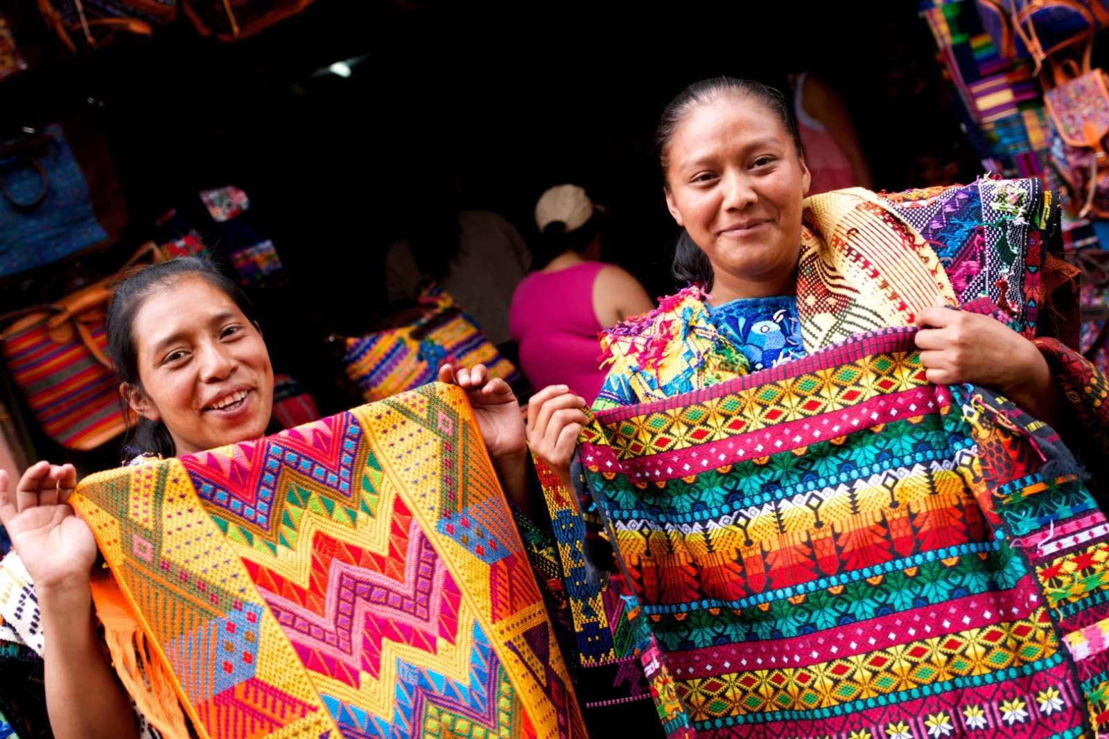 Two lady traders selling colourful throws at Chichicastenango, Guatemala