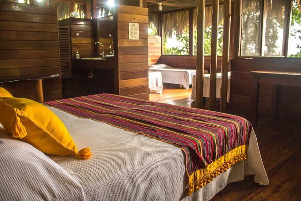 Bedroom at Chiminos Island Lodge at Petexbatun