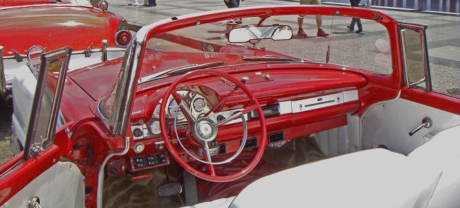 The driver's seat of a classic American car in Old Havana