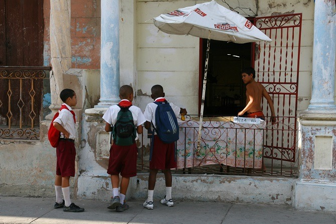 School kids buying pizza in Santiago de Cuba
