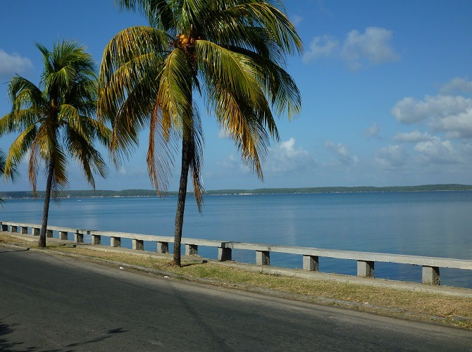 A road running alongside the Bay of Cienfuegos