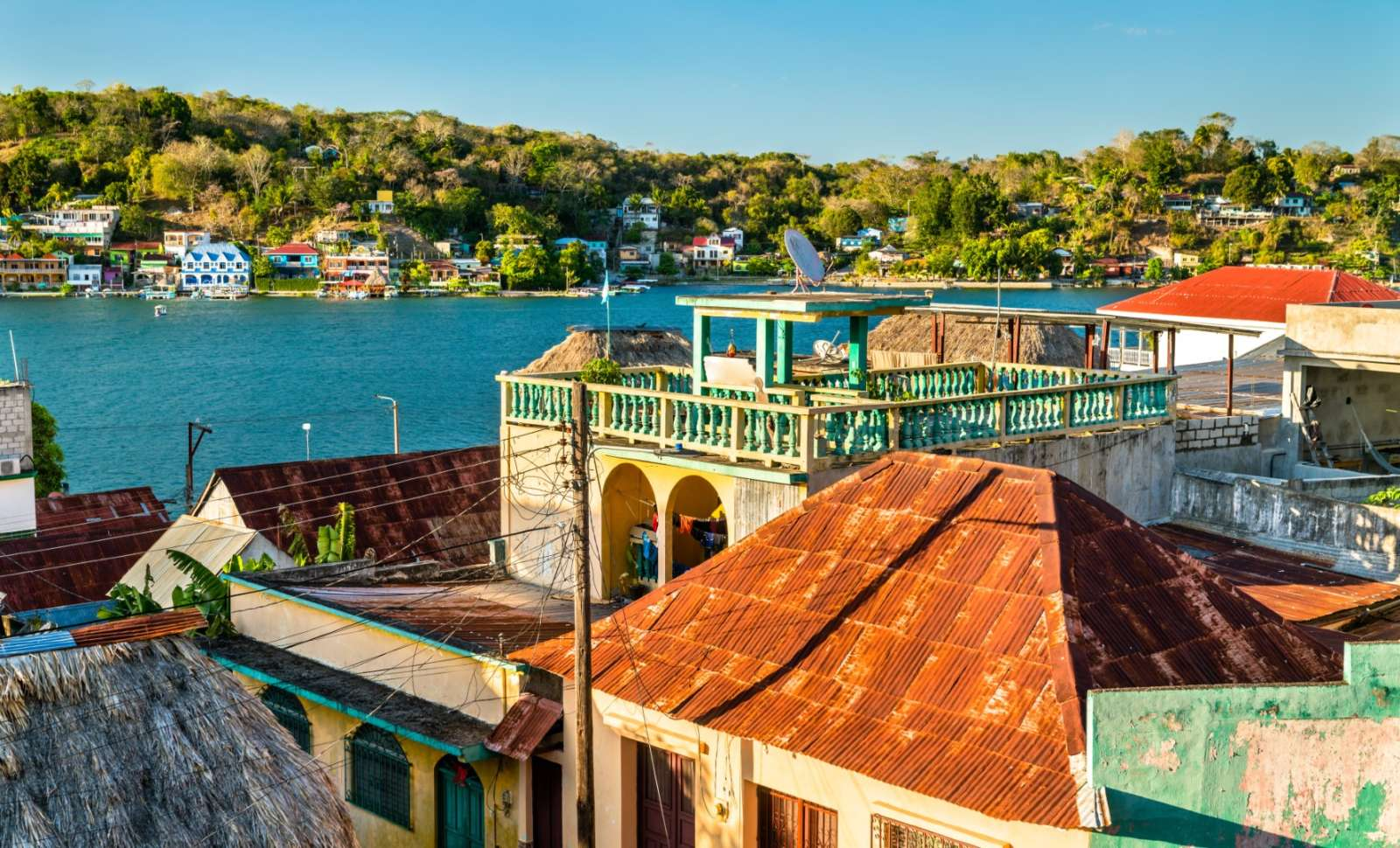 Rooftops of Flores, Guatemala with lakeview