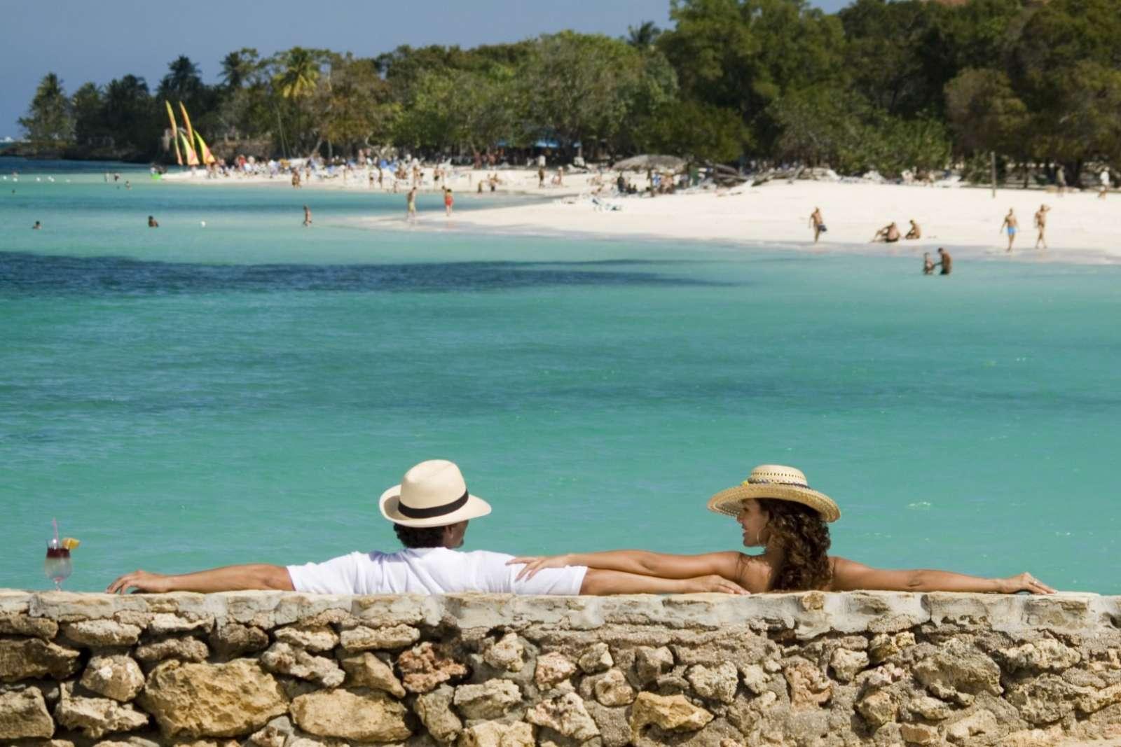 Couple overlooking a beach in Guardalavaca, Cuba