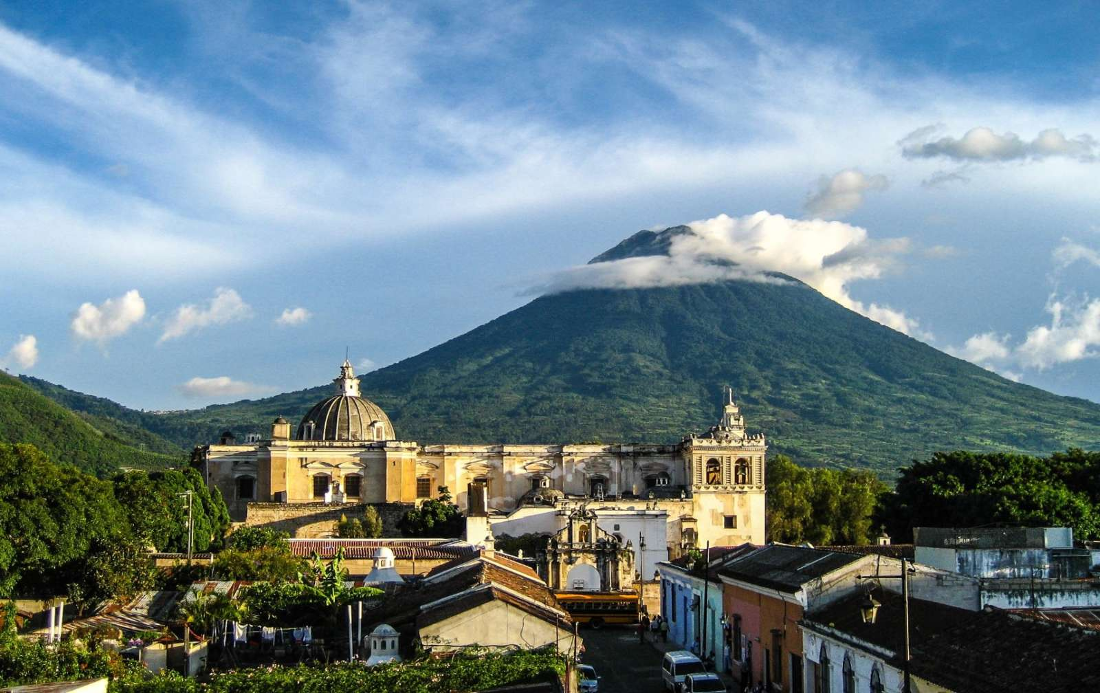 Rooftops of Antigua in Guatemala with volcano in background