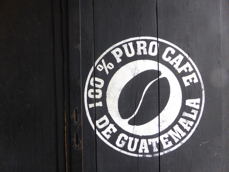 Sign on door advertising Guatemalan coffee