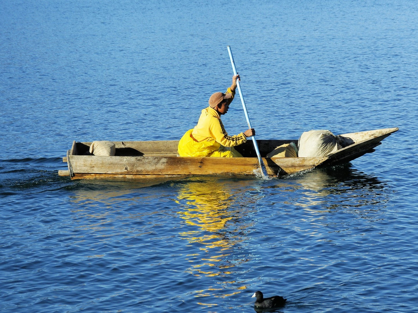 Man rowing small canoe on Lake Atitlan