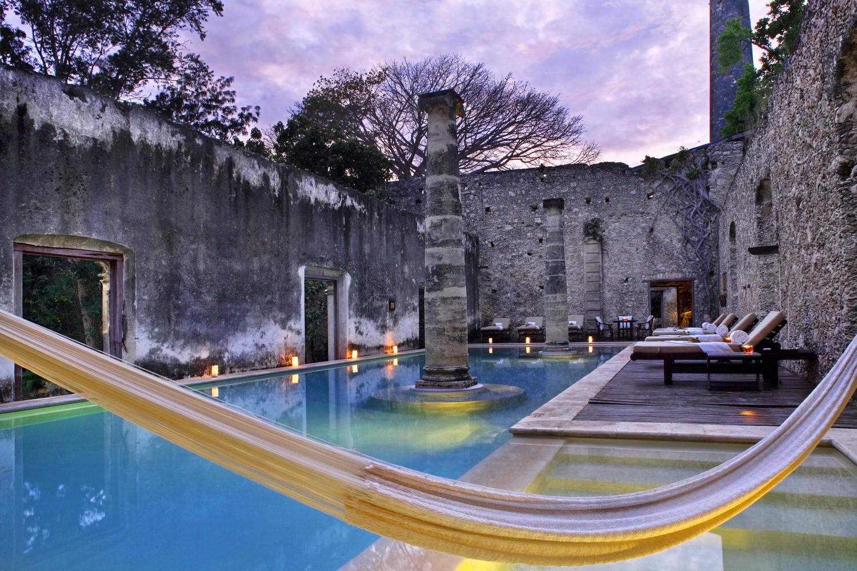 Pool with hammock at Hacienda Uayamon Campeche