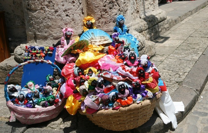 A basket of traditional Cuban dolls in Cathedral Square, Havana