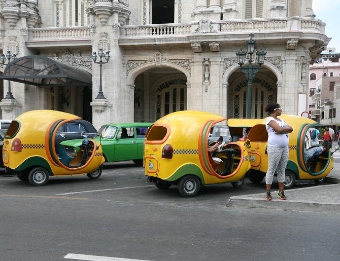Yellow, auto rickshaws in Old Havana, Cuba