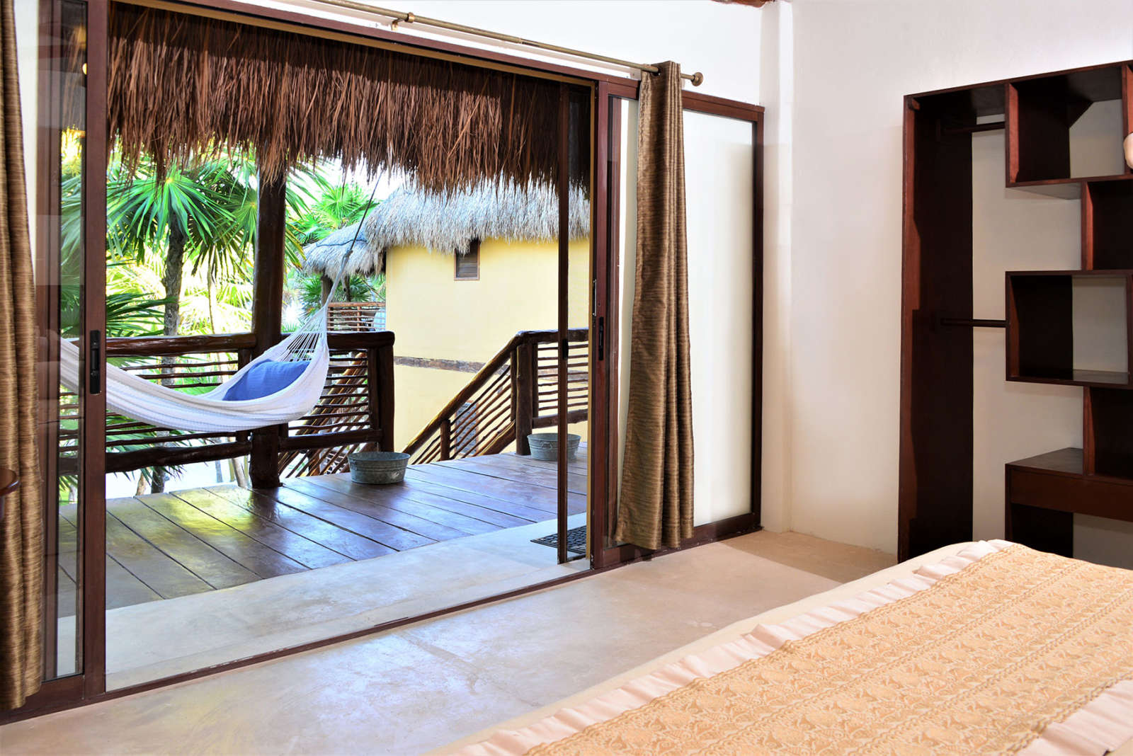 Bedroom and balcony at Hip Hotel Tulum