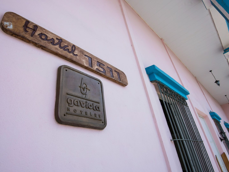 Entrance sign for Hostal 1511