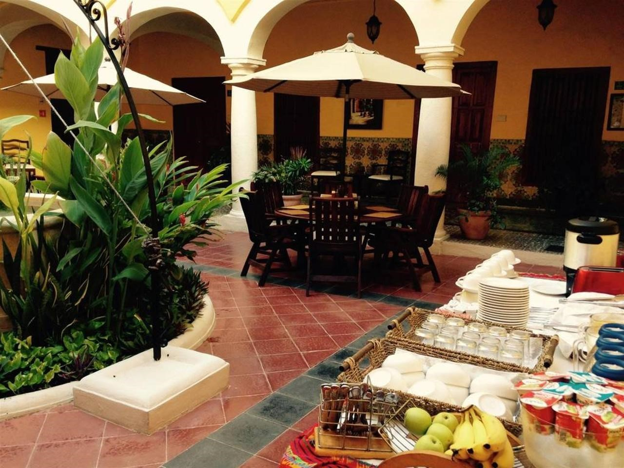 Breakfast in courtyard at Hotel Castelmar Campeche