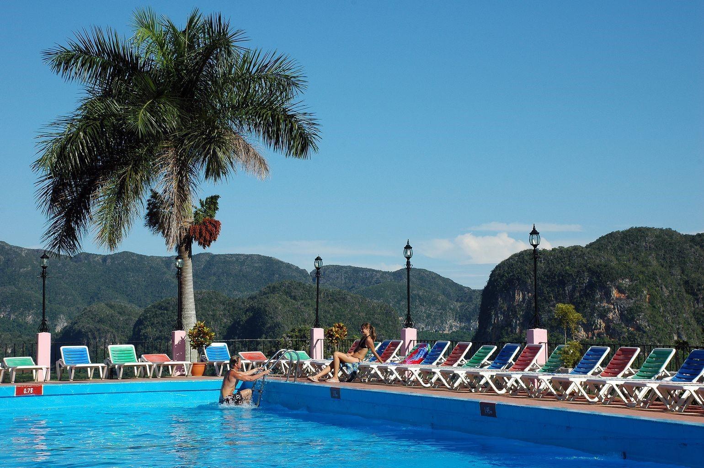 Man getting out of pool at Hotel Los Jazmines in Vinales, Cuba