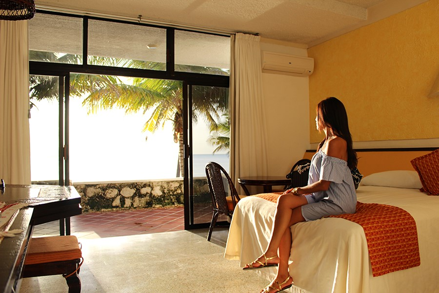 Woman in room at Hotel Tucan Siho Playa Campeche