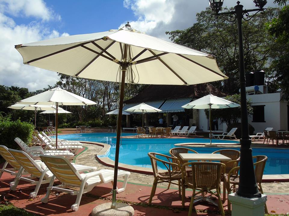 Umbrellas at the swimming pool of La Moka hotel in Las Terrazas, Cuba