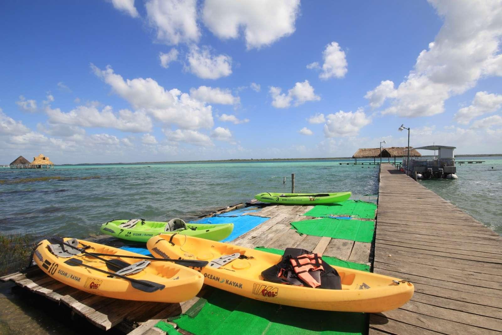 Kayaks on jetty at Laguna Bacalar
