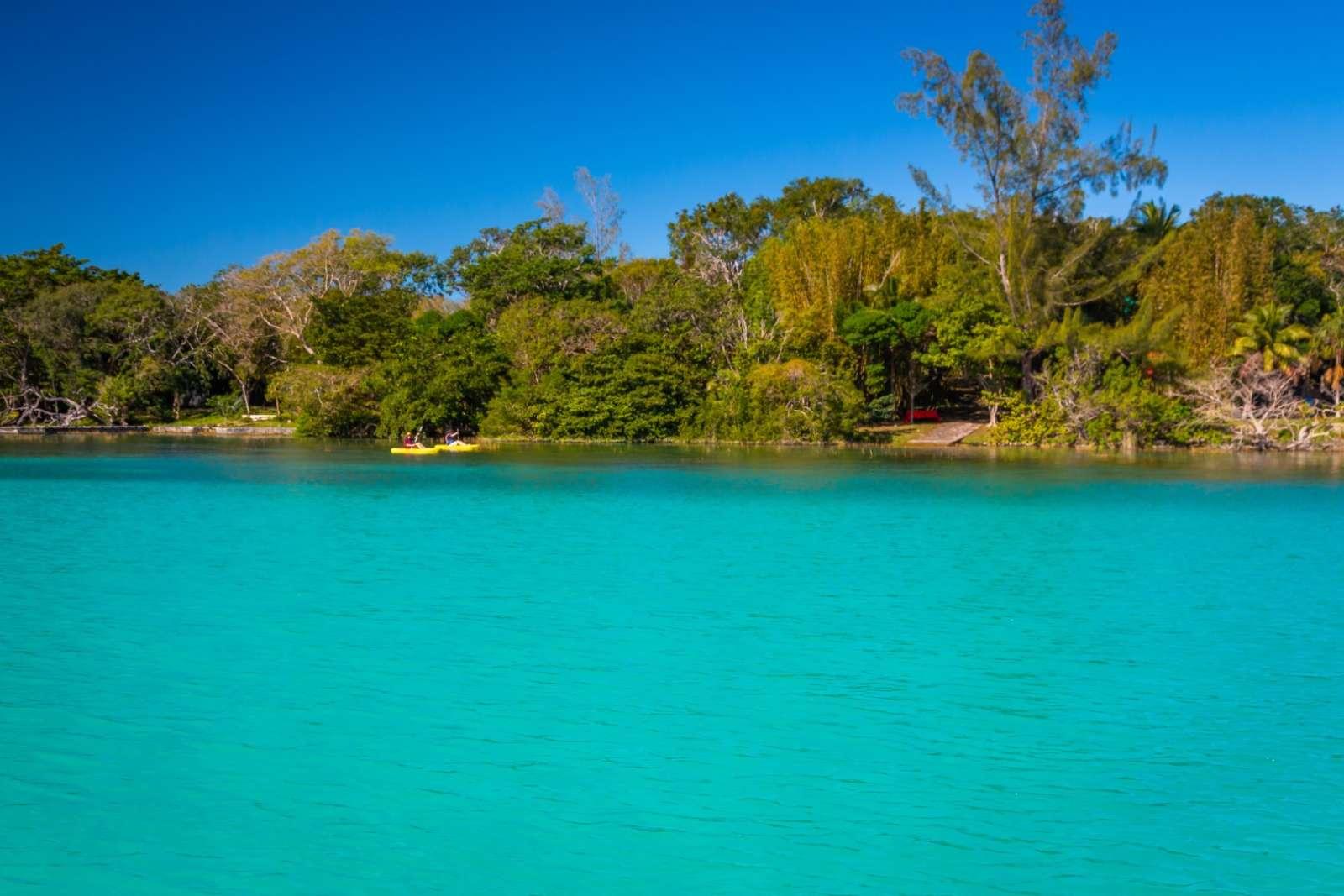 Two distant kayaks on Laguna Bacalar