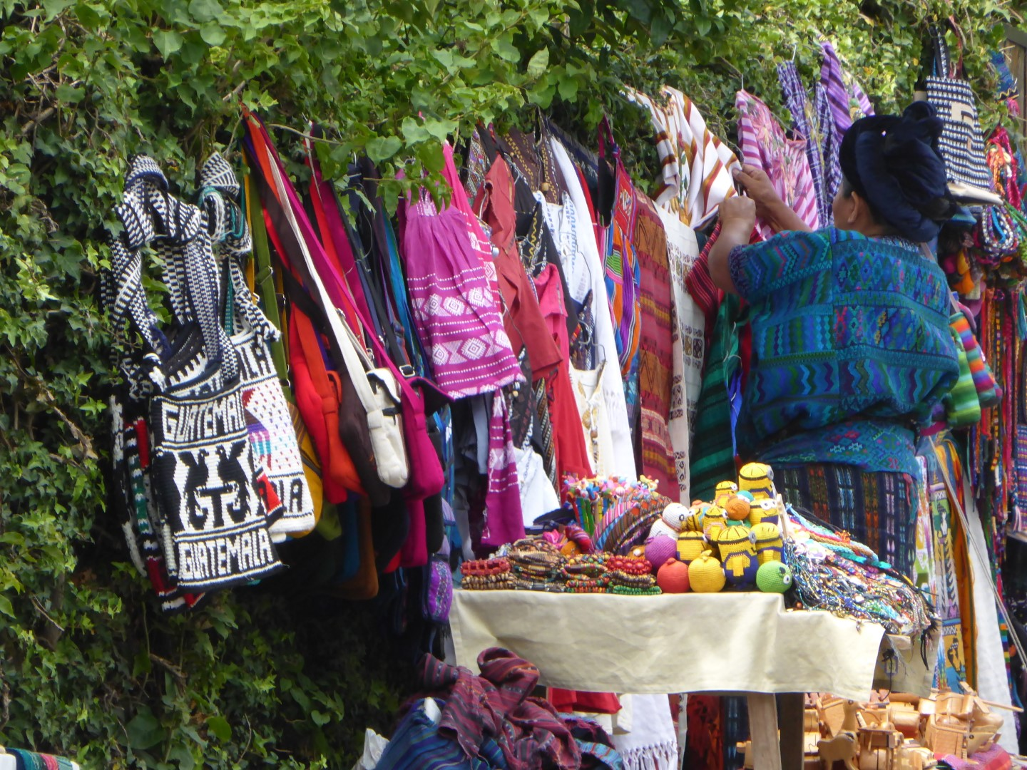 Hawker selling traditional goods at Lake Atitlan, Guatemala