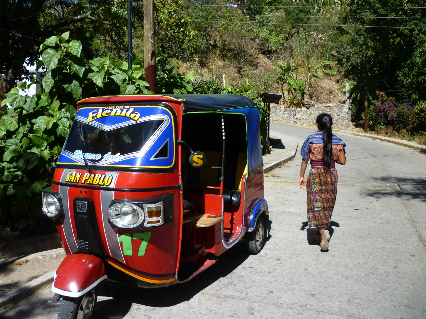 Rickshaw and Mayan woman Lake Atitlan, Guatemala