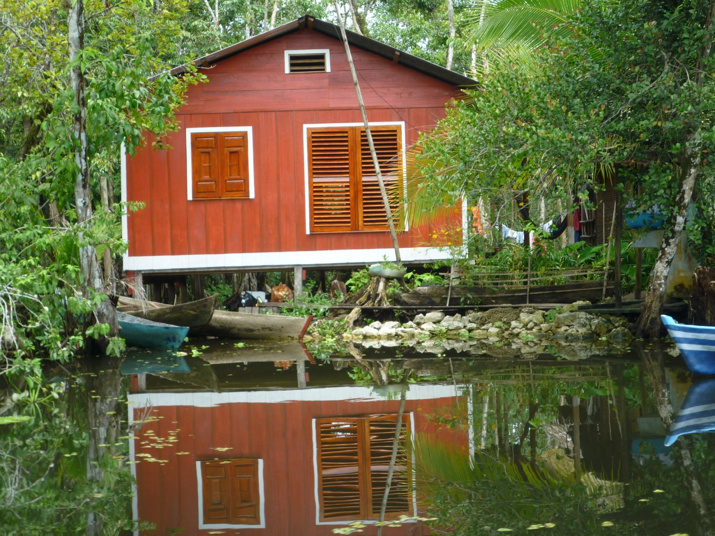 A traditional riversidee house on the Rio Dulce near Livingston, Guatemala