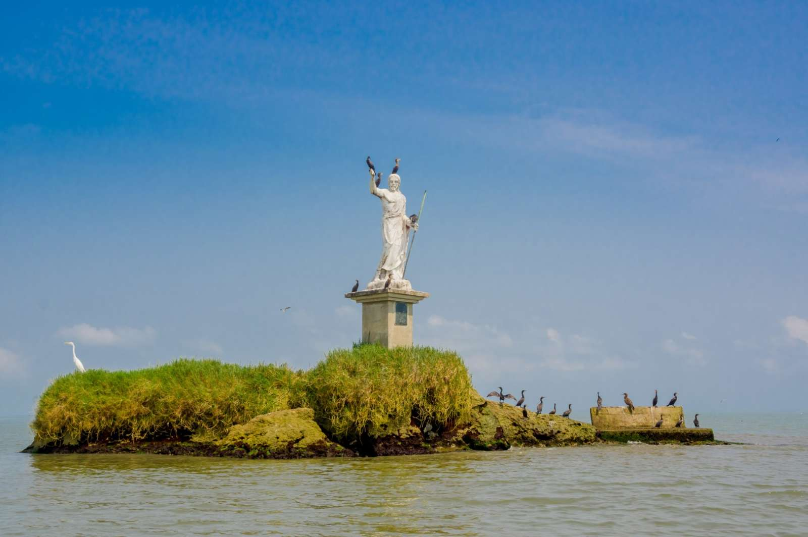 Statue at sea in Livingston, Guatemala