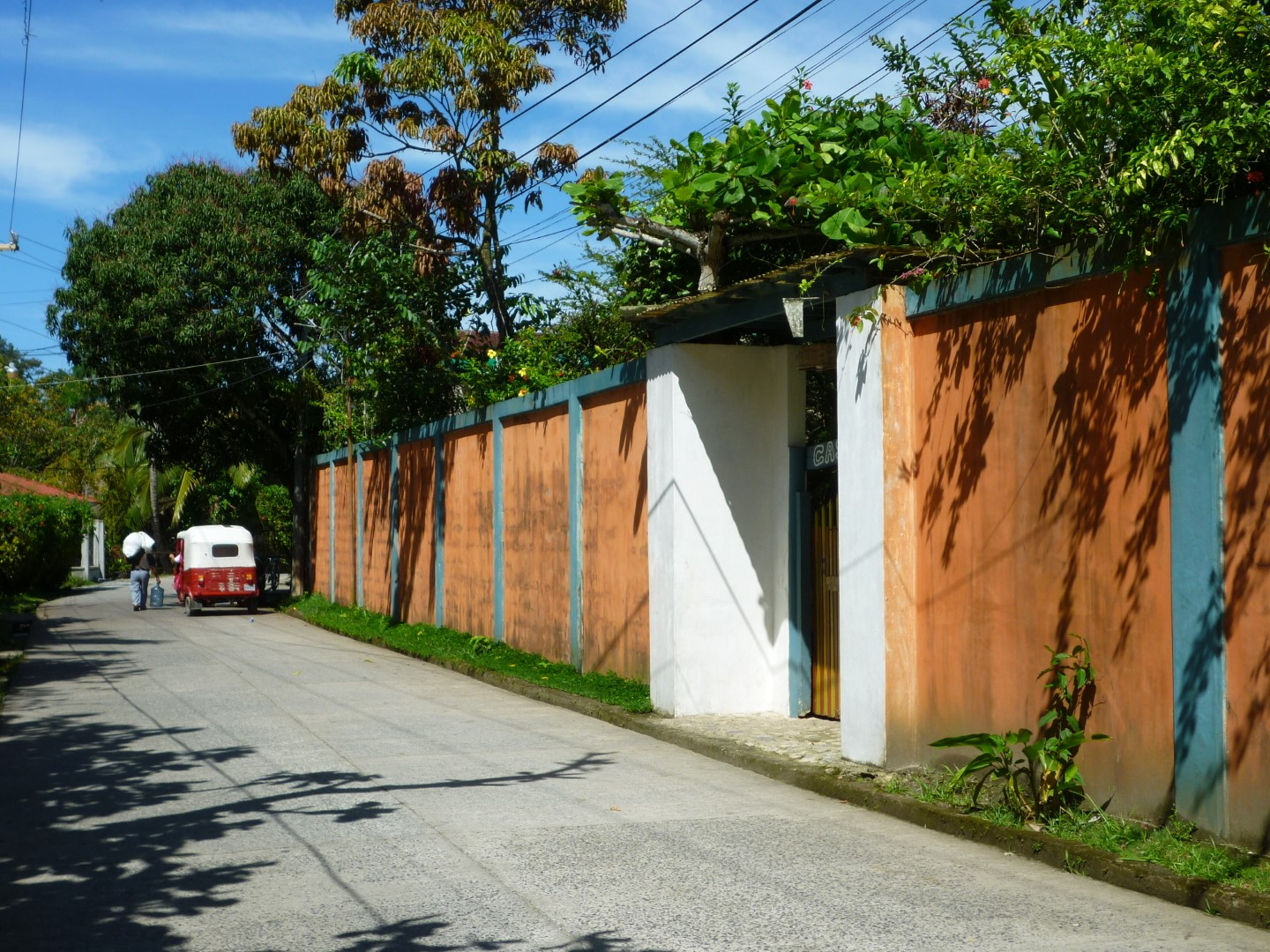 Wall alongside a quiet street in Livingston, Guatemala