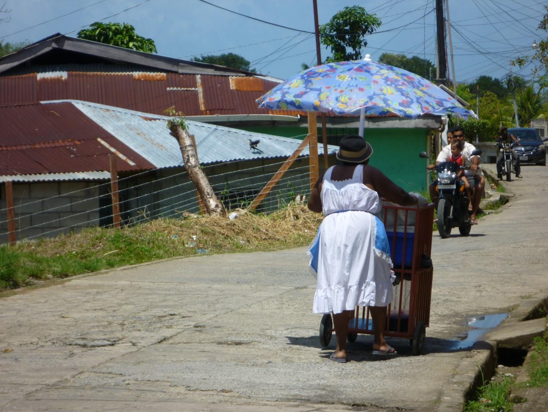 Woman pushing cart in Livingston, Guatemala