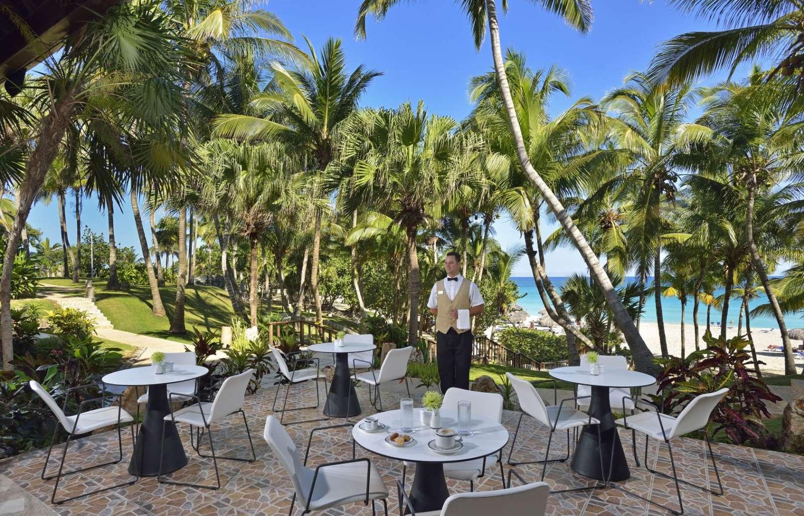 Waiter at Melia Las Americas beach view restaurant