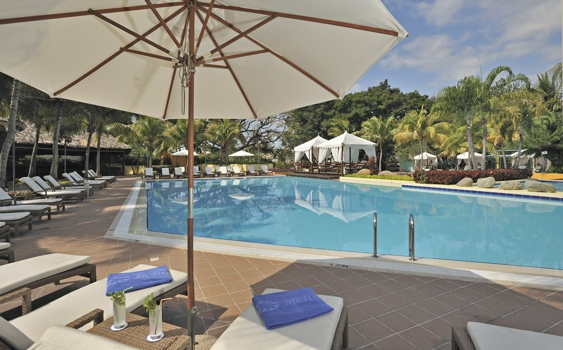 Umbrella at swimming pool of Melia Santiago