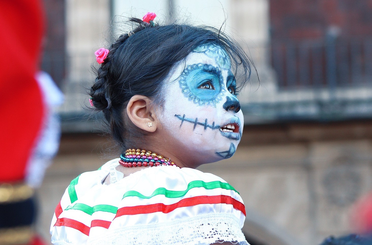 Young Mexican girl celebrating Day of the Dead