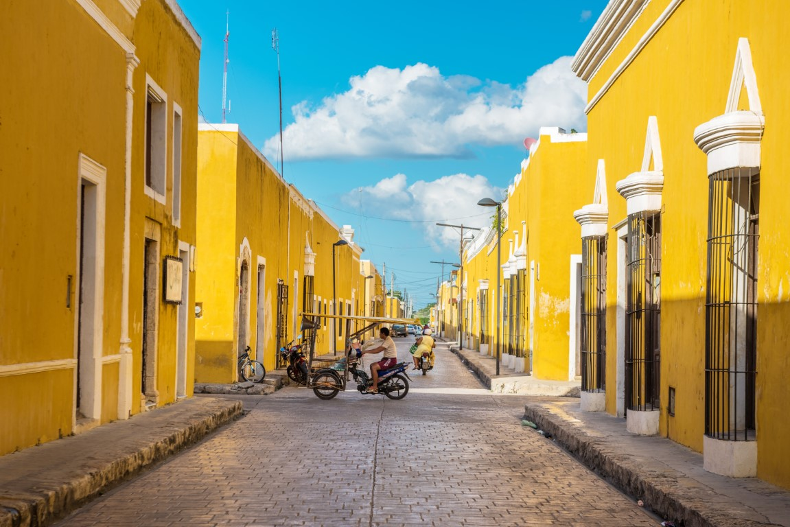 A bright yellow street in Izamal