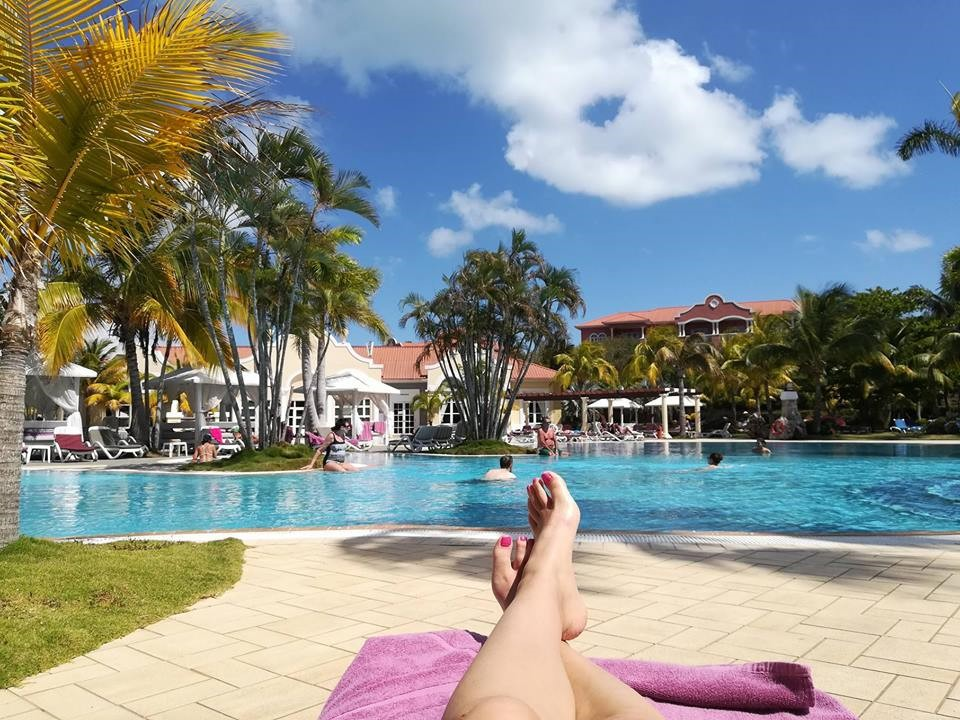 Woman's legs at pool of Paradisus Princesa Varadero
