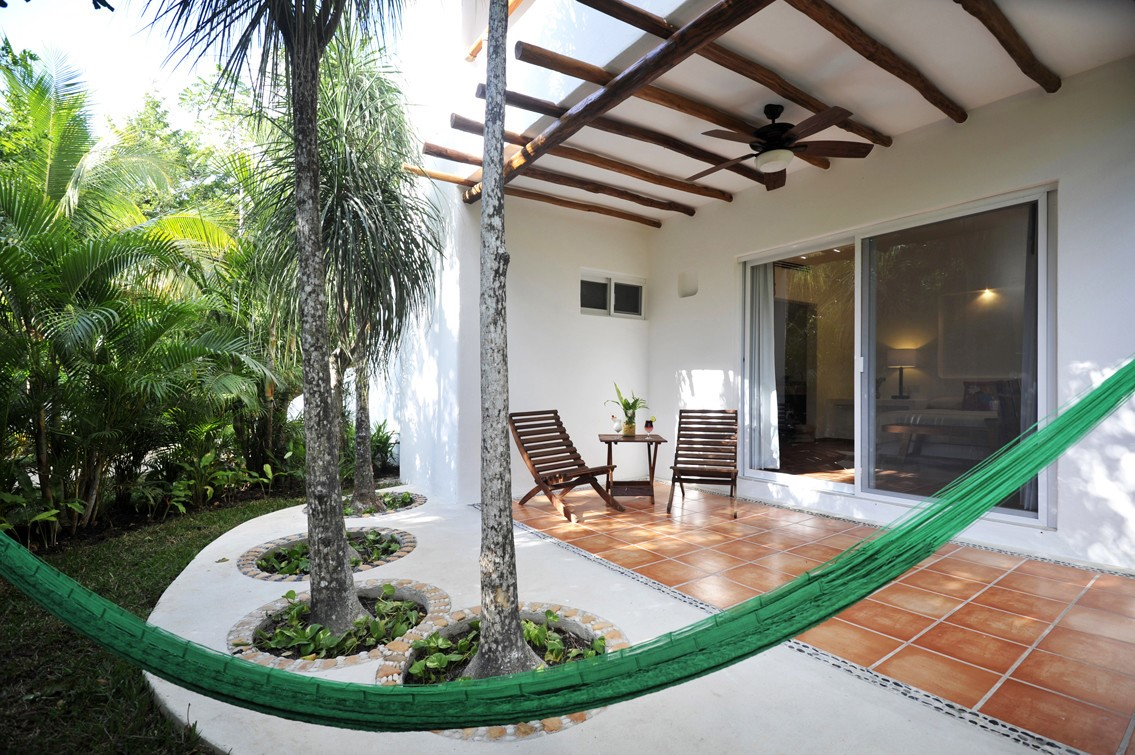 Terrace and hammock at Rancho Encantado Bacalar