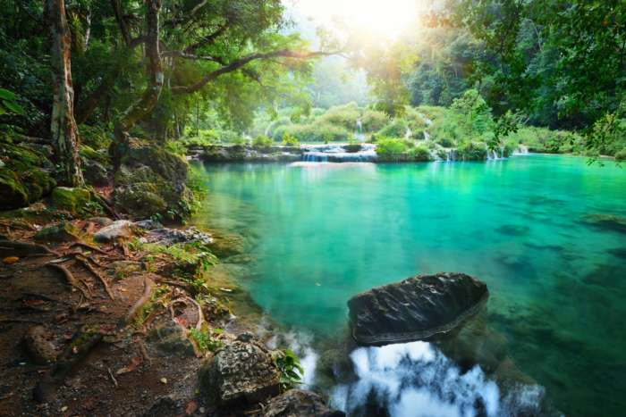 Clear pool at sunrise in Semuc Champey in Guatemala