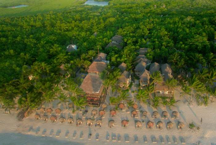 Aerial shot of a small beach hotel in Tulum, Mexico