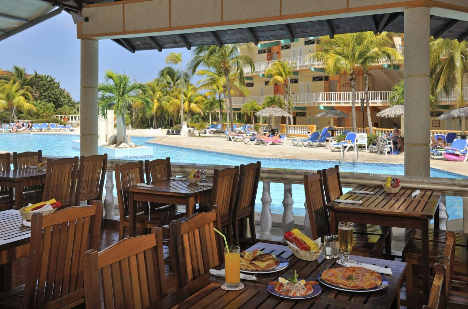 Poolside restaurant at Sol Rio De Luna Y Mares
